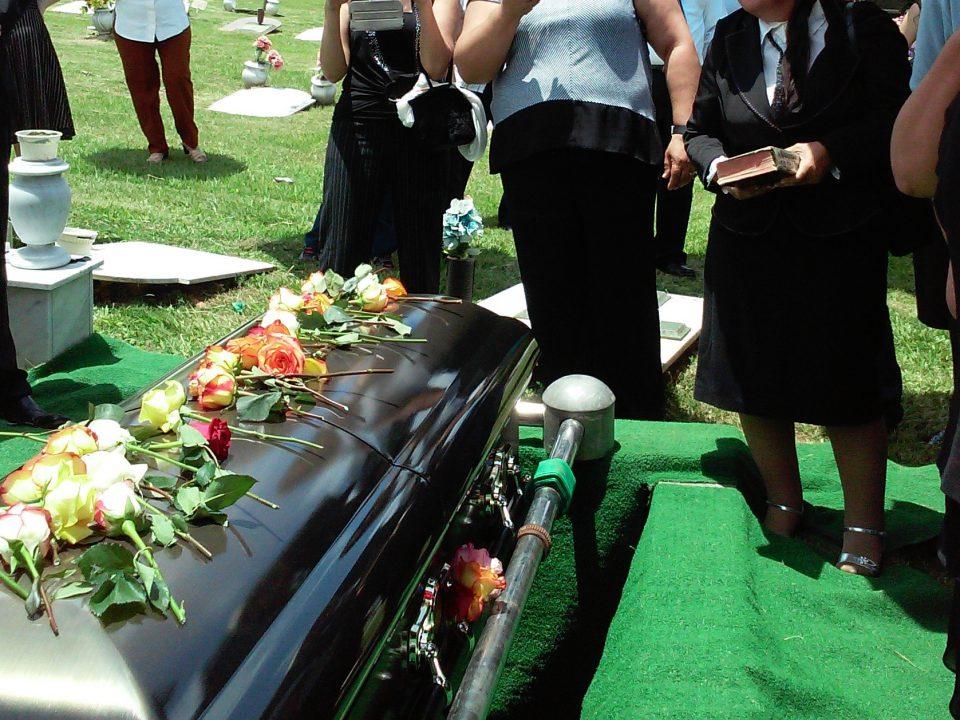 Family gathers at funeral. How much do funerals cost, and what are financing options?